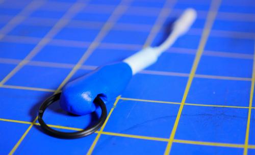 tu-tao-moc-khoa-kiem-thiet-bi-giu-adapter-tai-nghe-iphone-7-2