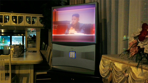 A large Toshiba TV screen shows North Korean leader Kim Jong Un attending the Supreme Peoples Assemblys yearly meeting at a hotel in Pyongyang, North Korea, Tuesday, Sept. 25, 2012.