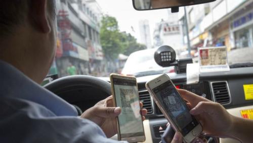 Thanh toán tiền taxi qua QR code đã trở nên rất phổ biến tại Trung Quốc.