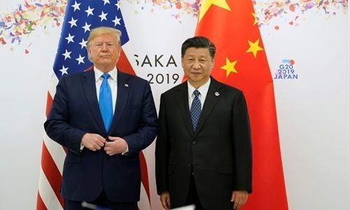 Tổng thống Mỹ Donald Trump (bên trái) và Chủ tịch Trung Quốc Tập Cận Bình (bên trái) tại G20. Ảnh: Reuters.