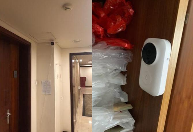 Camera lắp bên ngoài căn hộ của Lahiffe và trên tủ bên bên trong căn hộ của Zhou.