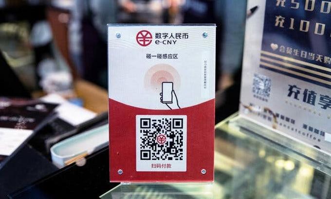 Một quầy giao dịch chấp nhận đồng nhân dân tệ điện tử ở Trung Quốc. Ảnh: New York Times.