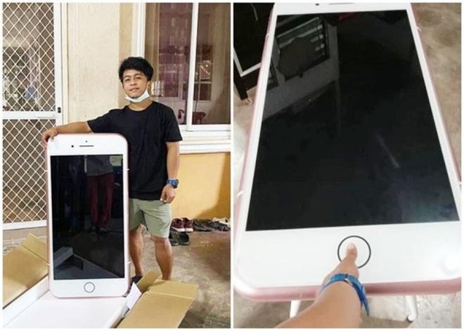 Người đàn ông cùng chiếc iPhone khổng lồ mua trên mạng. Ảnh: Oriental Daily.
